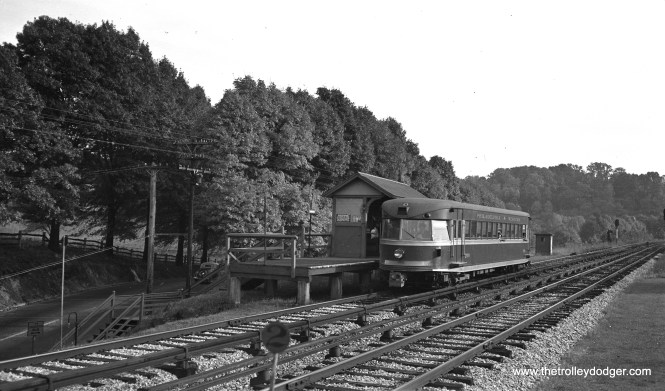 "Philadelphia & Western ""Bullet"" car 200 at Conshohocken Road on October 12, 1938, ""showing line country and streamlined car stopping at station."""