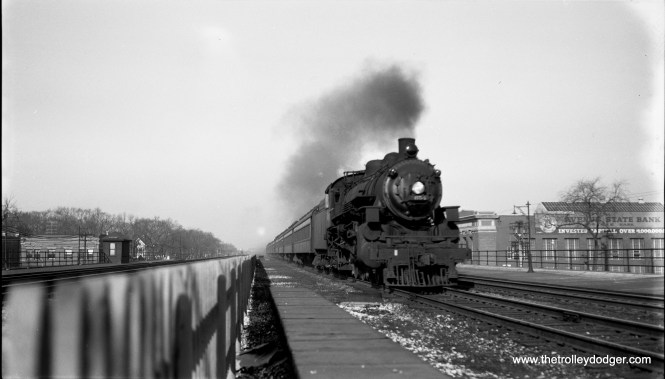 """8:05 am, Thursday morning, March 31, 1955: Chicago & North Western loco 654 (4-6-2), with commuter train, coming east toward camera at high speed at Oak Park Avenue, Oak Park, Il."" (Robert Selle Photo)"