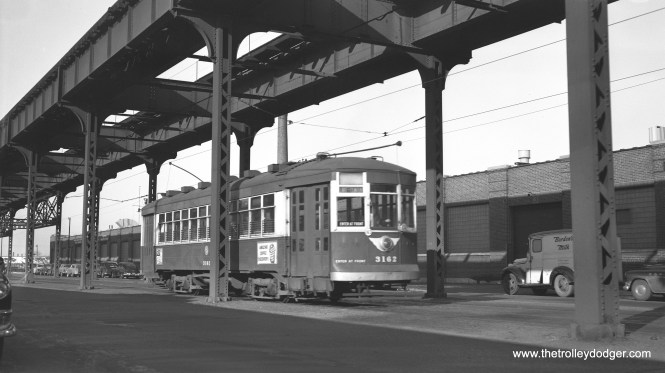 """CTA 1-man arched roof 3162 (in green and cream) on Lake Street, just west of Kostner (4400W), Saturday noon, November 28, 1953."" This was one of a handful of older streetcars that were repainted into a dark green by the CTA circa 195-54. (Robert Selle Photo)"