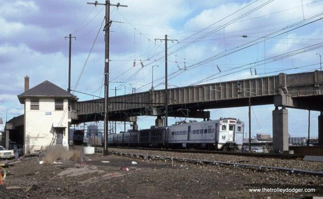 Photo 11. Arrow III MU #1483 leads a Trenton bound train at HUNTER Tower, Newark NJ. 1-26-97.