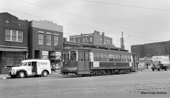 CTA 675 is westbound on Chicago Avenue at Grand Avenue on Route 66. Note the cool Bowman Dairy truck. (Robert Selle Photo, Wien-Criss Archive)