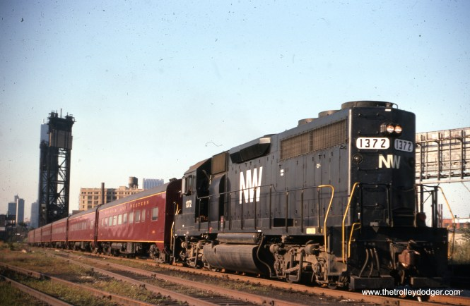 """Loco 137 on an Orland Park local, September 2, 1976. (Joseph Piersen Photo) Bill Shapotkin adds: """"Should be captioned as """"the"""" (not """"an""""), as at the time of the photo there was but one train each way, Mon-Fri. Additionally, at the time the pic was taken, the train was operating out of the N&W's own Chicago station -- located adjacent (to the west) of the vacant Dearborn Station."""""""