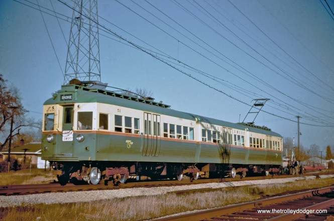 """When the CTA opened the five-mile long Skokie Swift branch in April 1964 (over a small portion of the former North Shore Line) ridership far exceeded expectations. So the four articulated 5000-series cars were quickly renovated and adapted for Swift service. These were experimental when built in 1947-48 and became """"oddballs"""" on the CTA system. Here, we see car 51 (renumbered from 5001) in October 1964 at Kostner. These cars continued to run into the 1980s. Two of the four sets were saved, and this set is now at the Fox River Trolley Museum. (Color correction by J. J. Sedelmaier)"""