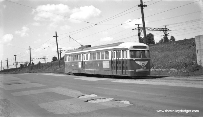 """""""One-man PCC 4021, now northbound on the (private right-of-way) portion of the South Cottage Grove line."""" This was on May 30, 1955. 4021 is now the only preserved prewar PCC, and is now at the Illinois Railway Museum. (Robert Selle Photo)"""