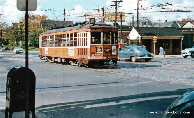TM 916 is eastbound, passing National car station at 27th and National.