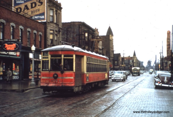 CTA one-man car 3224 is at 92nd and Baltimore. That's a bus trailing behind. (William Shapotkin Collection)