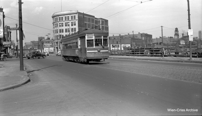 "CTA one-man car 1784 is heading southwest on Ogden (Route 58) at Van Buren and Honore. To the right, buildings are being cleared away for the Congress Expressway. To the north, you can see a Wieboldt's department store, which was located on Adams between Ogden and Ashland. The ""L"" to the rear is the Met branch leading to Logan Suare, already out of service for several months when this picture was taken in August 1951. The Garfield Park ""L"" would have been directly behind the photographer, smack dab in the middle of what became the expressway footprint. (Robert Selle Photo, Wien-Criss Archive)"