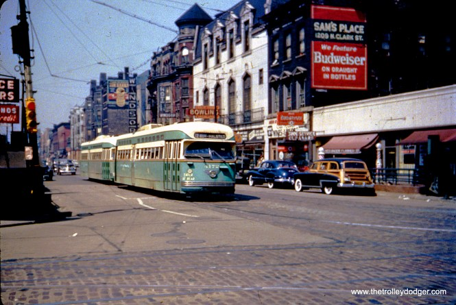 Chicago's PCCs did not operate in multiple units, but you would be forgiven for thinking so from this photo. Car 4172 and a very close follower are heading south at Clark and Division circa 1950. Note there are not yet any advertising brackets on the sides of the PCCs. At right, there is an entrance to a CTA subway station, which is today part of the Red Line.