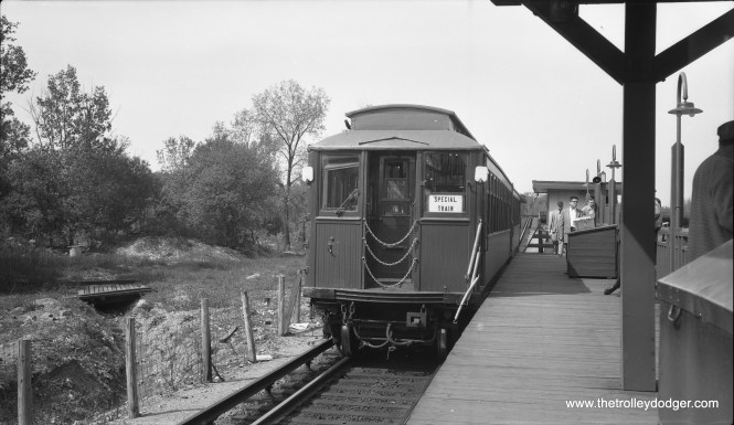 """On May 1, 1955 CERA held a fantrip using 2800-series wooden """"L"""" cars. Here, the train makes a photo stop at DesPlaines Avenue in Forest Park, then the western end of the Garfield Park """"L"""". The terminal had been reconfigured in 1953 when CA&E trains stopped running downtown. It would be reconfigured again in 1959. By 1960, the Congress expressway was extended through this area. (Robert Selle Photo)"""