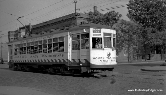 CSL 1775, decorated to promote the SPARS*, is on 119th one block west of Halsted in August 1943. Car 1775 was chosen for patriotic duty because that was the year the Revolutionary War broke out, with the Battles of Lexington and Concord. *The United States Coast Guard (USCG) Women's Reserve, better known as the SPARS, was the World War II women's branch of the USCG Reserve. It was established by the United States Congress and signed into law by President Franklin D. Roosevelt on 23 November 1942.