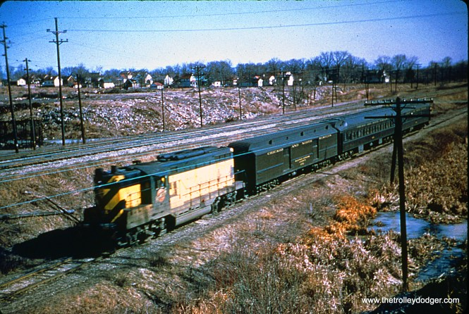 "C&NW GP7 is at an unknown location, on a morning train running between Milwaukee and Madison, Wisconsin in March 1954. Bill Shapotkin: ""This location is West Allis, WI just west of Belden Tower (the freight line to Butler is in background). View looks N/E."""
