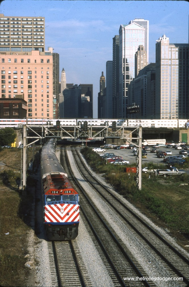 Metra loco #104 is seen heading a westbound Metra/Milwaukee District suburban train out from Union Station in August 1995. The view looks east from DesPlaines Street. (Dan Munson Photo)
