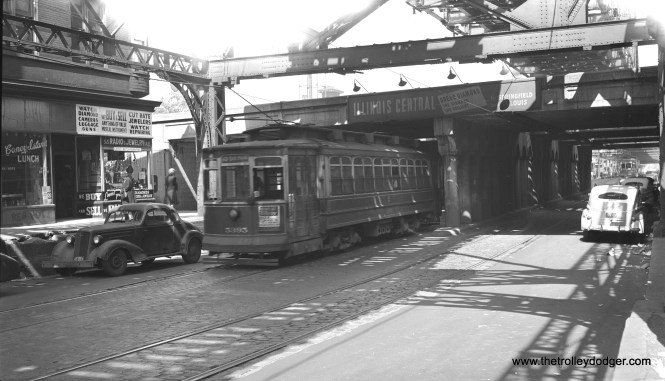 """CSL 5395 is westbound on 6rd Street at the Illinois Central underpass, east of Dorchester, on June 13, 1947. The """"L"""" has since been cut back to a point west of here at Cottage Grove. Its eventual destination will be Oak Park Avenue."""