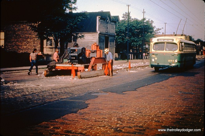 "This picture shows CTA trolleybus 234 (prior to the renumbering, where a ""9"" was added before all TB #s) running on the 51st-55th line. Perhaps the machine at left is removing streetcar track. Presumably this is the early 1950s. (William Hoffman Photo, Wien-Criss Archive)"