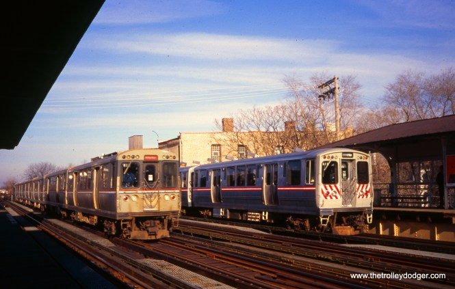 "At right, CTA cars 2411-2412 are on an NRHS (National Railway Historical Society) fantrip. At left, a southbound Howard-Dan Ryan train blasts by the Armitage station on the Ravenswood ""L"". William Shapotkin took this photo on December 13, 1998."