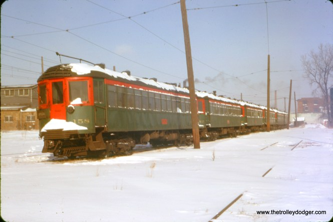 At first, you might think this lineup of NSL cars in dead storage at Highwood (headed up by 158) is post-abandonment, but apparently not. The slide not only has a 1/20/63 date stamped on it (last full day of operations), the slide was processed by Kodak in January 1963.
