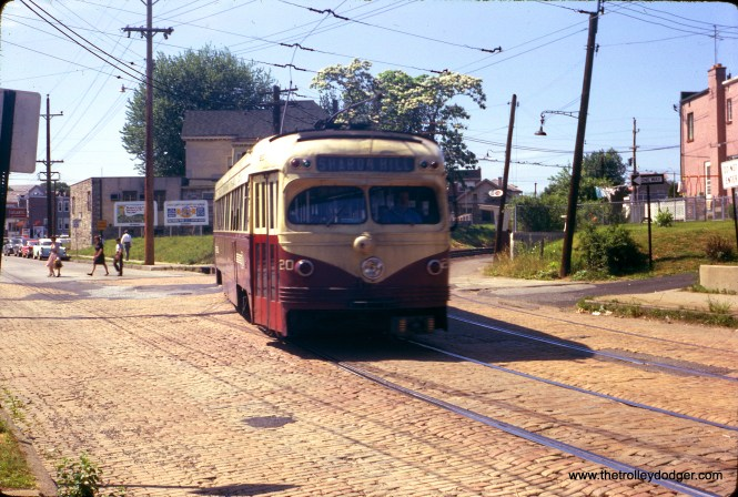 On June 3, 1962 Red Arrow car 20 is turning onto a cobblestone street on the Sharon Hill line.