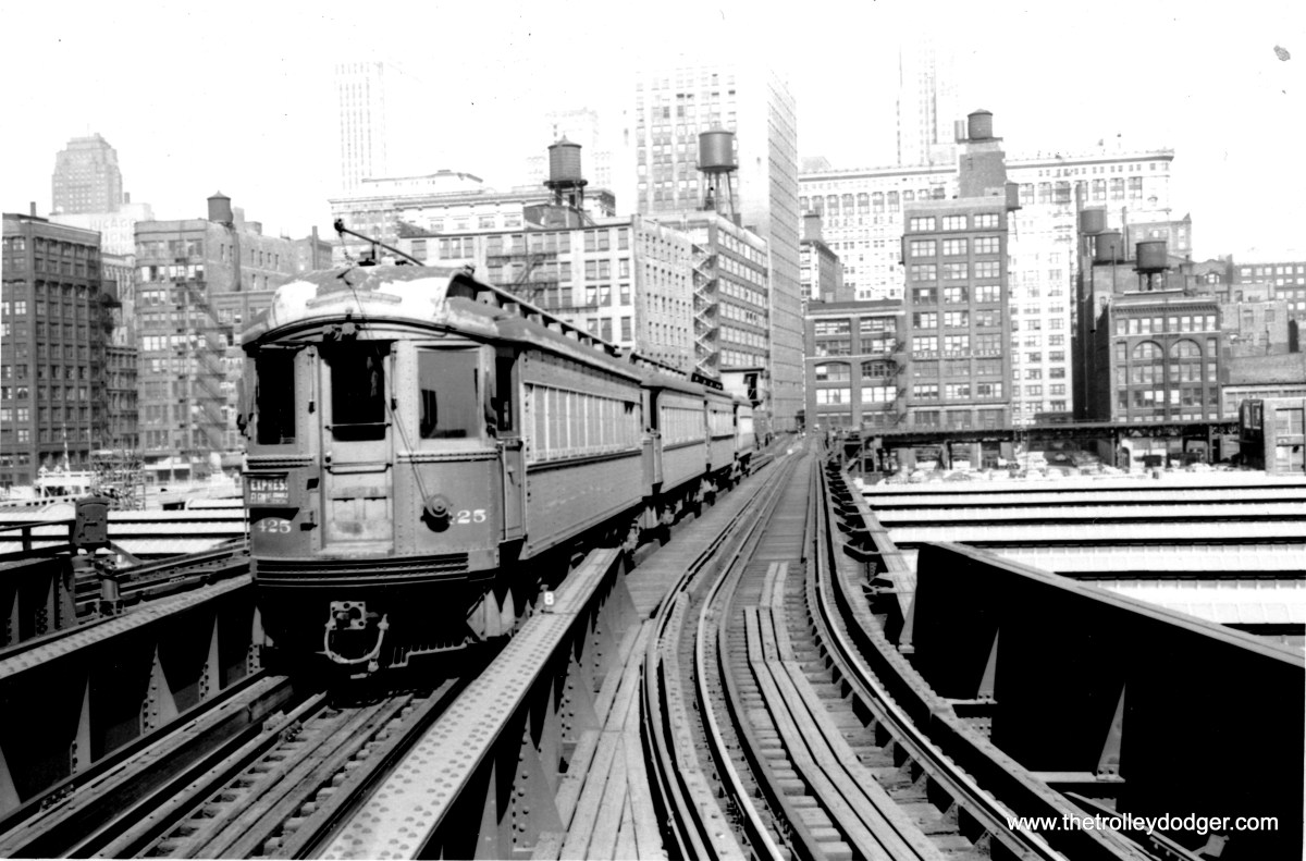 "CA&E 425 is passing over Union Station in this undated photo. Trains going more or less straight would end up at the Wells Street Terminal, while the tracks in the background leading off to the right connected to the Loop ""L"" Van Buren. When Lower Wacker Drive was being built, this necessitated tearing down this second connection to thee Loop, and building a new one through the second floor of Wells Terminal. The switchover between the two took place in 1955."