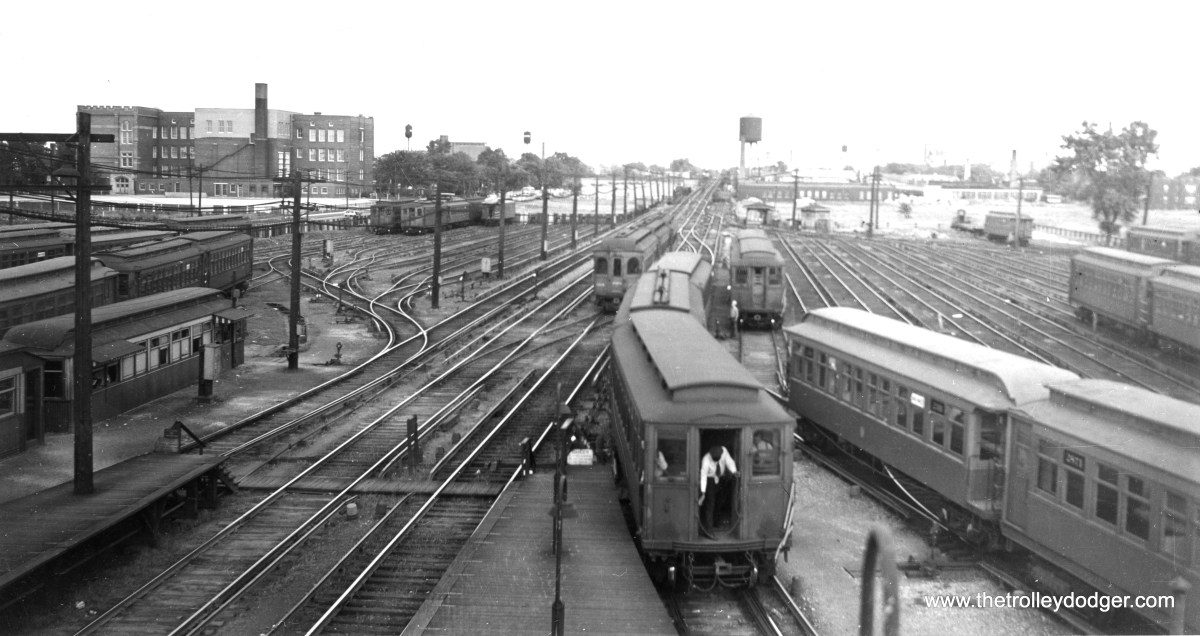 "Both CTA and CA&E trains are visible in this July 8, 1953 photo taken at Laramie on the Garfield Park ""L"". Just a little over two months later, the CA&E interurban cut back service to Forest Park, a few miles west of here (and behind the photographer)."