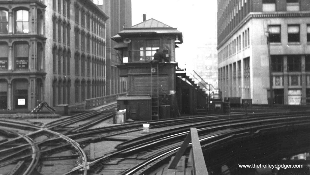 """Here is a view of the old Tower 18 on Chicago's Loop """"L"""", when this was the world's busiest railroad crossing. The old Loop ran both tracks in only one direction, but this changed in 1969, when the CTA wanted to connect the Lake Street """"L"""" with the new Dan Ryan line. Therefore, the old tower had to go, as it was situated right where the new tracks had to go."""