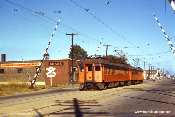 The presence of double track would seem to indicate that this picture of a South Shore Line train was taken in East Chicago, Indiana in the 1950s. The street running through the middle of town was replaced by a new section running parallel to the Indiana Toll Road in 1956.