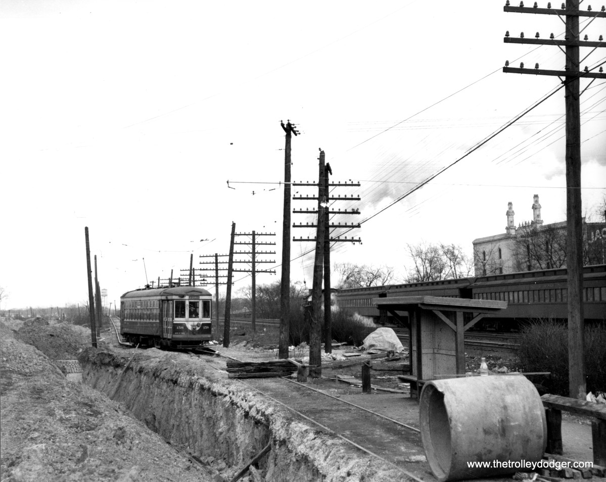 "C&WT 158 in LaGrange. Not sure why this section of track is blocked off, except that perhaps it is due to the tracks being unstable, due to the nearby excavation going on. (William Shapotkin Collection) Patrick Cunningham adds, ""C&WT 158 is just east of LaGrange Road. In the background, you can just make out the Jackson Moving and Storage sign on the building with the towers. The building is there, the towers are gone. Probably about here: https://www.google.com/maps/@41.8166104,-87.8687401,3a,75y,70.46h,80.48t/data=!3m6!1e1!3m4!1st0yuoCYe7FXm6EGEmBkuQA!2e0!7i16384!8i8192!5m1!1e1"