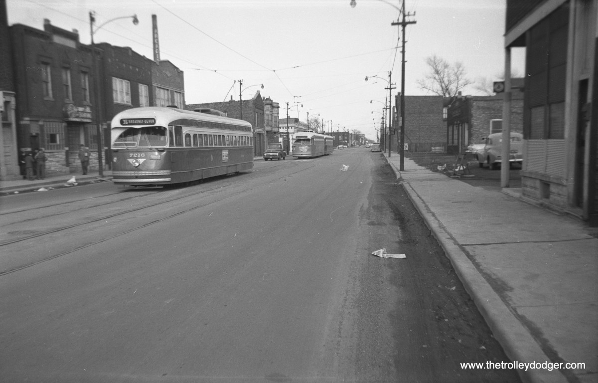 """CTA 7216, a St. Louis Car Company PCC, is northbound on Route 36 - Broadway in the 1950s. Jeff Wien: """"Cars laying over on 119th at Morgan."""""""