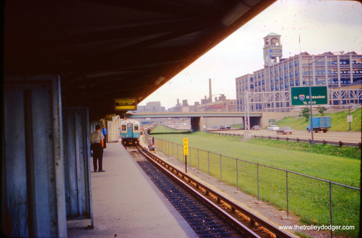 "On July 27, 1962, a CTA Douglas Park ""B"" train pulls away from us at the Racine stop on the Congress rapid transit line., then only four years old. The train will do downtown through the Dearborn Subway, and then out to Logan Square via the Milwaukee Avenue tube."