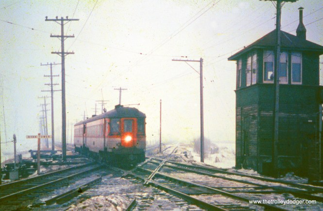On the stretch between Milwaukee limits and Racine station, a North Shore train crosses North Western freight route at Ryan Road. (A. C. Kalmbach Photo, William Shapotkin Collection)