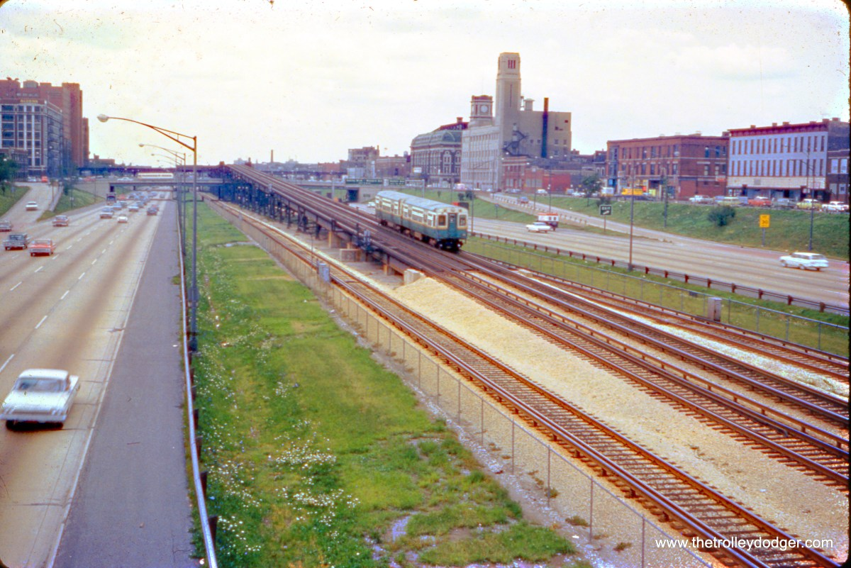 """An outbound CTA Douglas Park train ascends the ramp that will take from the Congress (now Eisenhower) Expressway to the old """"L"""" structure in the mid-1960s. This ramp is not used much now, as Douglas trains, now renamed the Pink Line, have been rerouted to the Lake Street """"L"""" via the Paulina Connector. (Mark D. Meyer Photo)"""