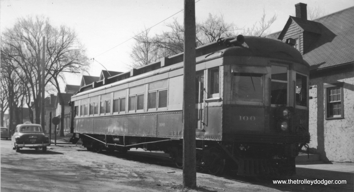 """Waterloo Cedar Falls and Northern car 100. This car is featured on Railroad Record Club LP #2. Don's Rail Photos: """"100 was built by McGuire-Cummings in 1914. It was built as a second motor to operate behind the 140s as a two car train. The baggage compartment was a kitchen, and the rear end was an open platform observation. The buffet section was replaced with coach seats in 1918. The car was then rebuilt with a control station and baggage compartment in 1928 and the rear platform was enclosed at that time. It was the last interurban left on the WCF&N when it became diesel freight, and it was donated to the Iowa Chapter of the NRHS in 1956. It was moved to Centerville and operated on the Southern Iowa Ry. When the SI cut back its operation and dieselized, the Iowa Chapter transferred the car to the Iowa Terminal RR in 1966. Shortly after it was repainted and put into charter service, it was destroyed in the carbarn fire early November 24, 1967. It had been the only car saved from the WCF&N roundhouse fire on October 31, 1954, when the other two cars of its class burned."""""""