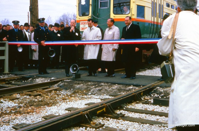 "On April 20, 1964, CTA and local officials cut the ribbon at Dempster, commencing service on the new five-mile-long Skokie Swift line. This represented but a small portion of the Chicago North Shore and Milwaukee interurban that abandoned service on January 21, 1963. The Chicago Transit Authority had to purchase about half of the Swift route anyway, as their connection to Skokie Shops went over NSL tracks. The CTA decided to offer an express service between Dempster and Howard stations, and put in a large parking lot. Service was put into place using existing equipment at the lowest possible cost. The late George Krambles was put in charge of this project, which received some federal funding as a ""demonstration"" service, at a time when that was still somewhat unusual. But CTA officials at the time indicated that they would still have started the Swift, even without federal funds. I was nine years old at the time, and rode these trains on the very first day. I can assure you they went 65 miles per hour, as I was watching the speedometer. Needless to say, the experiment was quite successful, and service continues on what is now the Yellow Line today, with the addition of one more stop at Oakton. (Richard Hofer Photo, David Stanley Collection)"