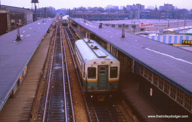 In October 1966, a southbound Howard train has just left Howard terminal, and a single-car Evanston shuttle train has taken its place. After its riders depart, it will change ends on a siding just south of the station, and then head north after picking up passengers at the opposite platform.