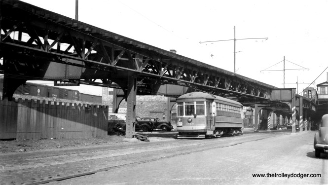 "CSL 1616 heads west on Lake Street in the 1940s, with the Lake Street ""L"" station at Laramie in the background. The ""L"" went down an inclined ramp and ran on the surface to Forest Park, and paralleled the streetcar line for a few blocks."