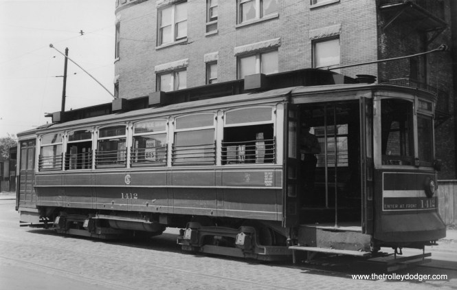 """CSL """"Matchbox"""" 1412 is on the Morgan-Racine-Sangamon route in this photo by Edward Frank, Jr. Don's Rail Photos adds, """"1412 was built by St Louis Car Co in 1906 as CUT 4641. It was renumbered 1412 in 1913 and became CSL 1412 in 1914. It was retired on March 30, 1948... These cars were built by St. Louis Car in 1903 and 1906 for Chicago Union Traction Co. They are similar to the Robertson design without the small windows. Cars of this series were converted to one man operation in later years and have a wide horizontal stripe on the front to denote this. Two were used for an experimental articulated train. A number of these cars were converted to sand and salt service and as flangers."""" Car 1374 in this series has been lovingly restored to operating condition, at the Illinois Railway Museum."""