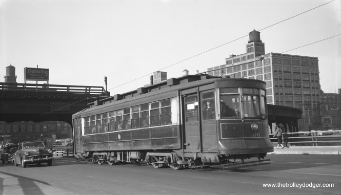 "On May 12, 1954, Bob Selle took this picture of CTA Pullman 600, southbound on Route 8 - Halsted. This was less than three weeks before the end of streetcar service on this line. We are just south of the Metropolitan ""L"" station at Halsted, and crossing over the Congress Expressway construction. That looks like a Studebaker at left."