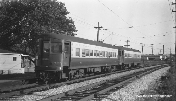 CA&E 457 at the front of a two-car train near the end of either the Aurora or Elgin terminals, as it is operating with overhead wire instead of third rail.