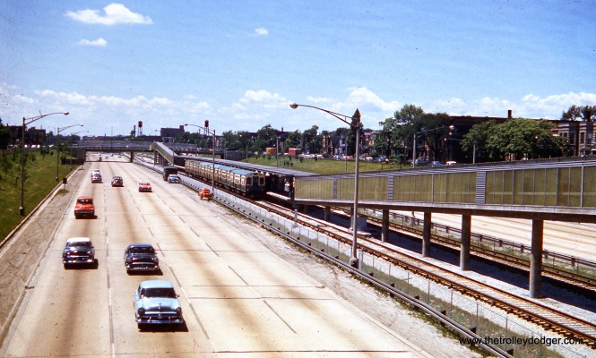 "On June 21, 1958 an eastbound CTA train is in the station at Pulaski Road on the new Congress rapid transit line, then also known as the West Side Subway. Notice how little fencing there was separating the right-of-way from the highway. Eventually, this was replaced by concrete Jersey barriers after numerous vehicle crashes that impacted the ""L"". That way, when something hits the fence, it can take a ""Jersey bounce."""