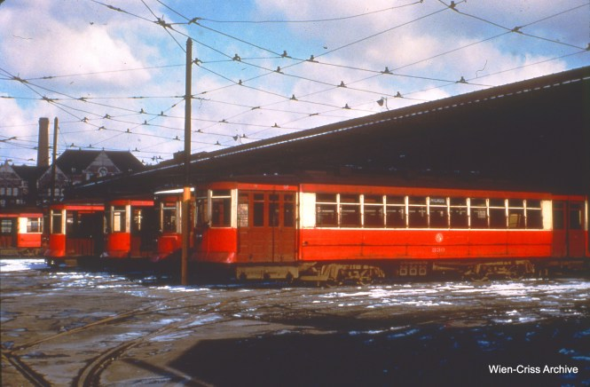 CTA 330 and others are at the Kedzie and Van Buren car barn (station) on March 13, 1951.