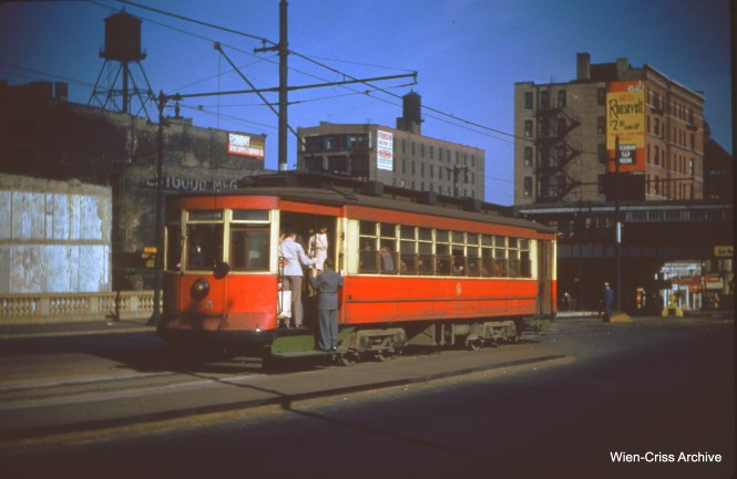 CTA 695 is eastbound on Roosevelt at State on October 29, 1950.