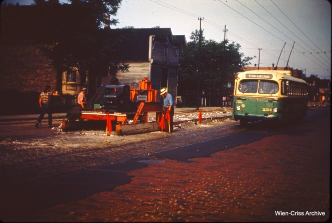 CTA trolley bus 234 is at 51st and Campbell on June 12, 1950, where it appears streetcar tracks are being removed from the pavement.