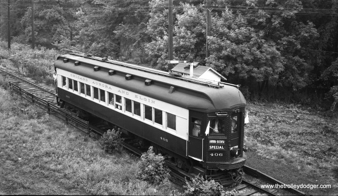 "Here is Chicago, Aurora & Elgin car 406 on a Central Electric Railfans' Association fantrip on August 8, 1954. Photographer Bob Selle notes, ""View from abandoned power house-- second story. At Glenwood Park station. Photo stop between Batavia and the Junction."" (In other words, on the Batavia branch.)"