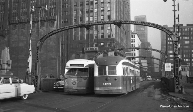 CTA PCCs 4103 and 4076 pass each other while crossing the Chicago River on Madison Street. Note the difference in fonts used for the numbers. Nowadays, transit agencies have style manuals, used to maintain consistency, but such was not the case in the early 1950s. Note the circa 1953 Cadillac at left. (Wien-Criss Archive)
