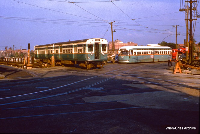 "PCC meets PCC in this famous Bill Hoffman photo, showing CTA PCC streetcar 4373 on Western Avenue, while a Garfield Park ""L"" train crosses on Van Buren temporary trackage. The date is June 16, 1954. (Wien-Criss Archive)"