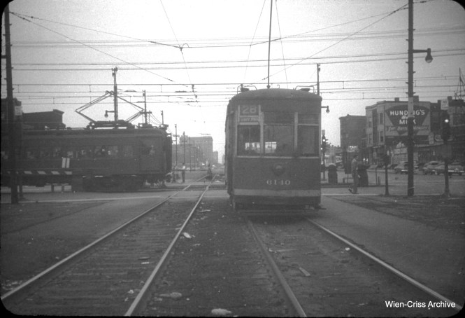 On June 25, 1951, CTA 6140 is heading southbound on Stony Island, while waiting for an Illinois Central Electric commuter train to pass, before crossing 71st Street. (William C. Hoffman Photo, Wien-Criss Archive)
