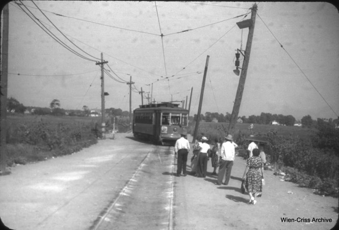"On August 10, 1947, we are looking east along 63rd Place at Oak Park Avenue. A Chicago Surface Lines Pullman streetcar is switching onto single track at the west end of Route 63. There was a shuttle operation west of here, perhaps  a mile of single track, to Archer Avenue and the area of suburban Summit widely known as ""Argo,"" although there is no such municipality. That is the name of a large factory there that makes Argo cornstarch. (William C. Hoffman Photo, Wien-Criss Archive)"