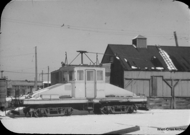 CTA electric locomotive L202, coupled to a railroad gondola in the 39th and Halsted yards. (William C. Hoffman Photo, Wien-Criss Archive)