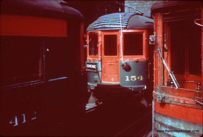 """NSL cars 412, 154, and 767 at Roosevelt Roard on Chicago's """"L"""" system on October 24, 1962. (John D. Horachek Photo, William Shapotkin Collection)"""