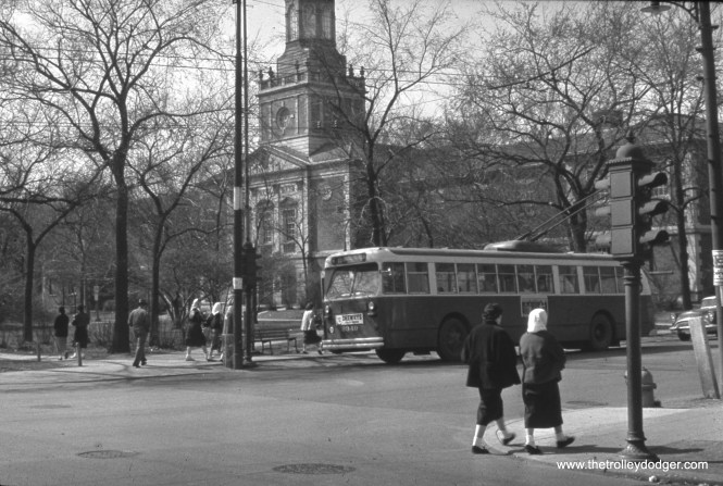 CTA trolley bus 9349 is southbound on Central Avenue at Lake Street. In the background, we see the Austin Town Hall, which was built decades after the town of Austin was annexed into the City of Chicago. (William Shapotkin Collection)