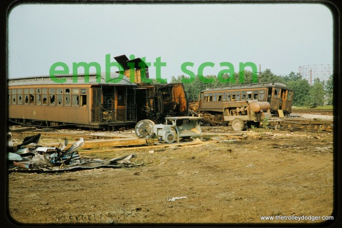 """CTA wooden """"L"""" cars, including 345 at left, and a Met car at right, being scrapped at Skokie Shops in September 1957."""